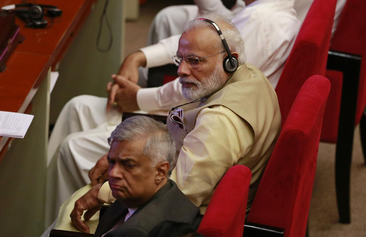Indian Prime Minister Narendra Modi, top, and his Sri Lankan counter part Ranil Wickremesinghe listen to a speaker during the UN celebration of Vesak ceremony or Buddha Purnima in Colombo, Sri Lanka, Friday, May 12, 2017. During his two-day visit Modi participated in the United Nations celebration of Vesak or the day of birth, enlightenment and death of the Buddha. He also inaugurated a modern hospital for the benefit of tea plantation workers , ancestors of Indian laborers brought by the British from the 18th century.