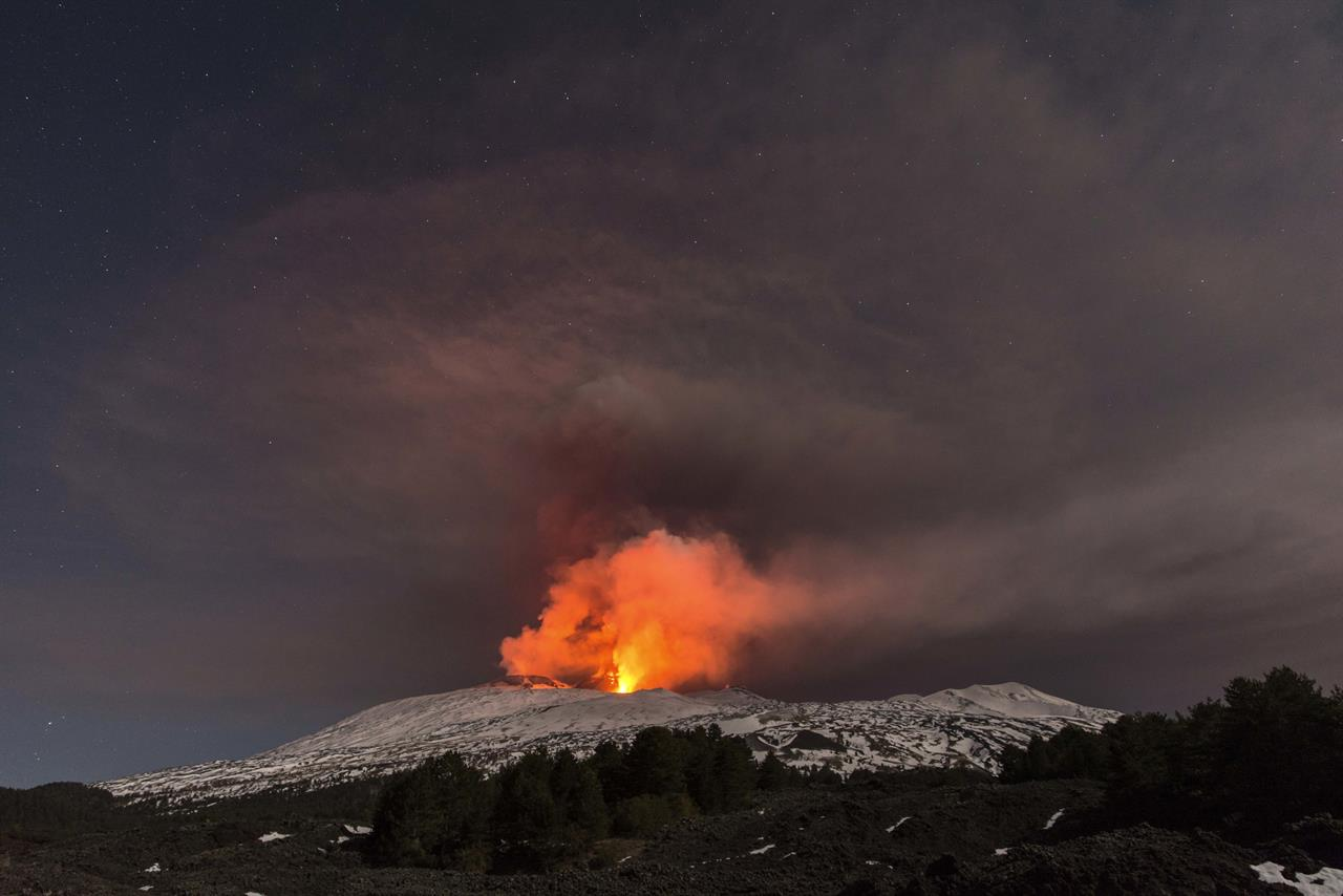Snow-covered Mount Etna, Europe's most active volcano, spews lava during an eruption in the early hours of Thursday, March 16, 2017. A new eruption which began on March 15 is causing no damages to Catania's airport which is fully operational.