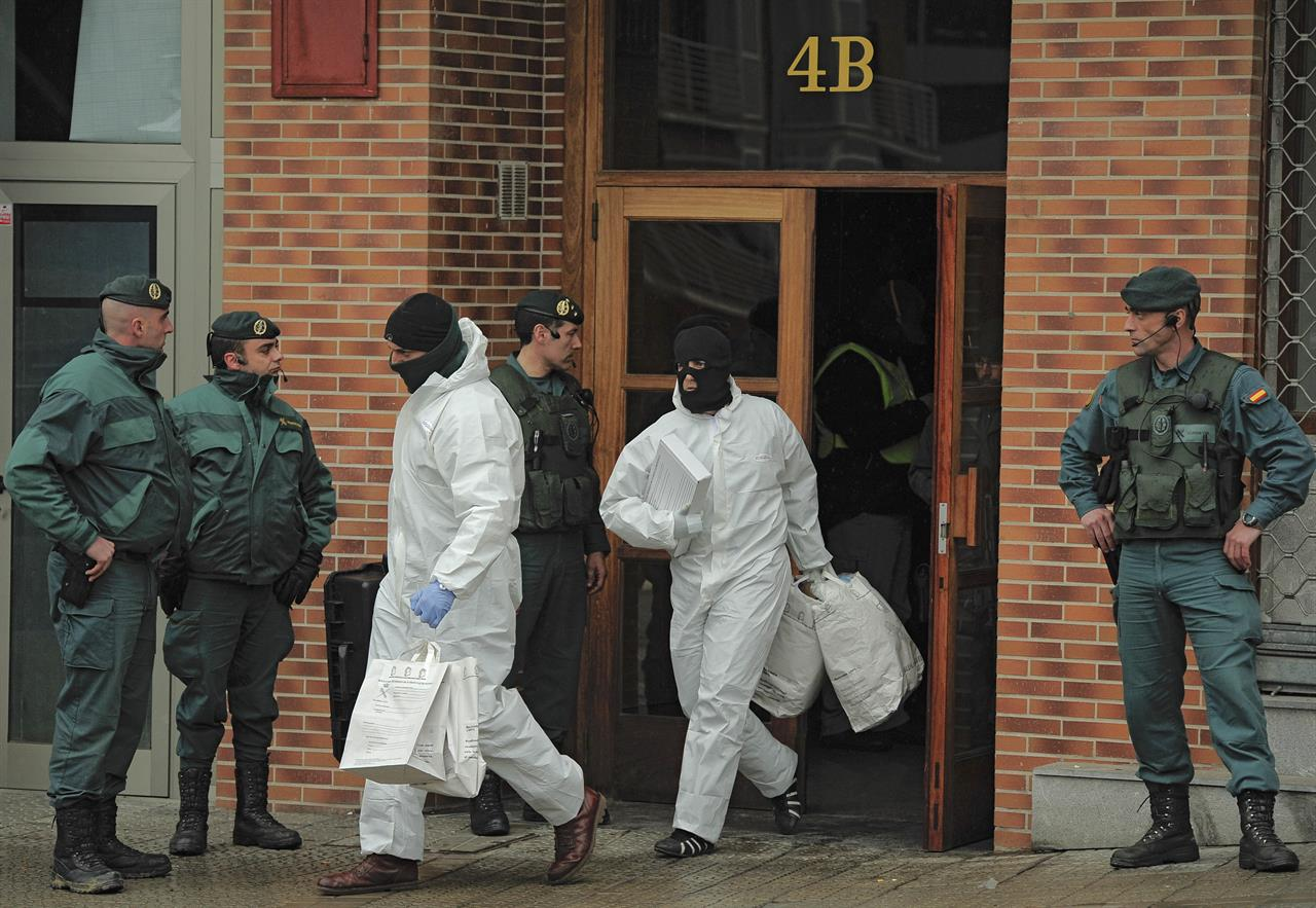 In this March 1, 2011 file photo, Spanish Civil Guards leave a building with several bags after they arrested Daniel Pastor, an alleged member of the Basque separatist group ETA in Galdakao northern Spain. Spanish media are reporting that ETA are set to announce Friday March 17, 2017 its new initiative to lay down weapons aimed at speeding the stalled process of disbanding.