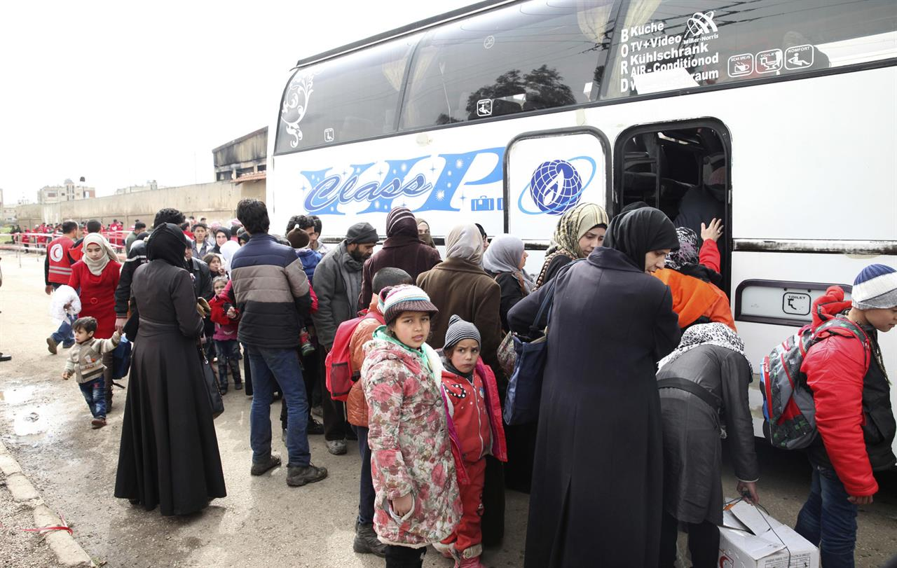 Women and children board buses to leave the al-Waer neighborhood bound for a town on the Turkish border, in Homs, Syria, Saturday, March 18, 2017. Scores of Syrian opposition fighters and their families have begun leaving al-Waer, the last rebel-held neighborhood in the central city of Homs as part of a Russian-backed evacuation deal signed earlier this week. The city was once known as the epicenter of the 2011 uprising against President Bashar Assad.