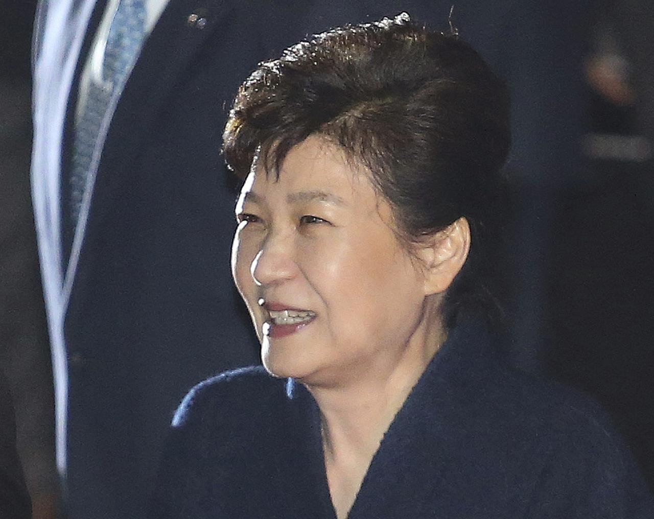 In this Sunday, March 12, 2017 photo, ousted South Korean President Park Geun-hye smiles as she is greeted by supporters upon her arrival at her private home in Seoul, South Korea. Park expressed defiance toward the corruption allegations against her as she vacated the presidential palace and returned to her home on Sunday, two days after the Constitutional Court removed her from office.