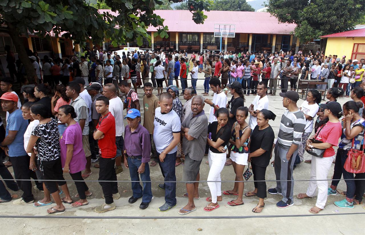 People queue up to give their vote during the presidential election at a polling station in Dili, East Timor, Monday, March 20, 2017. East Timorese went to vote Monday in the first presidential election since the U.N. officially ended the peacekeeping mission in the country in 2012.