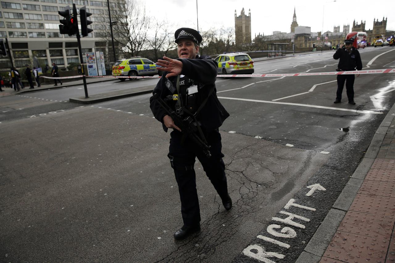 The Latest: UK Parliament observes minute of silence