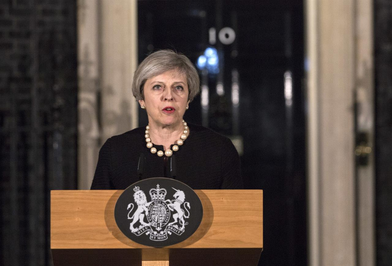 Britain's Prime Minister Theresa May gives a media statement outside 10 Downing street in London, Wednesday March 22, 2017, following a terror attack in the Westminster area of London earlier Wednesday. A knife-wielding man went on a deadly rampage, Wednesday, plowing a car into pedestrians on London's Westminster Bridge before stabbing an armed police officer to death inside the gates of Parliament. Four people were killed, including the attacker, and about 20 others were injured in what authorities called a terrorist incident.