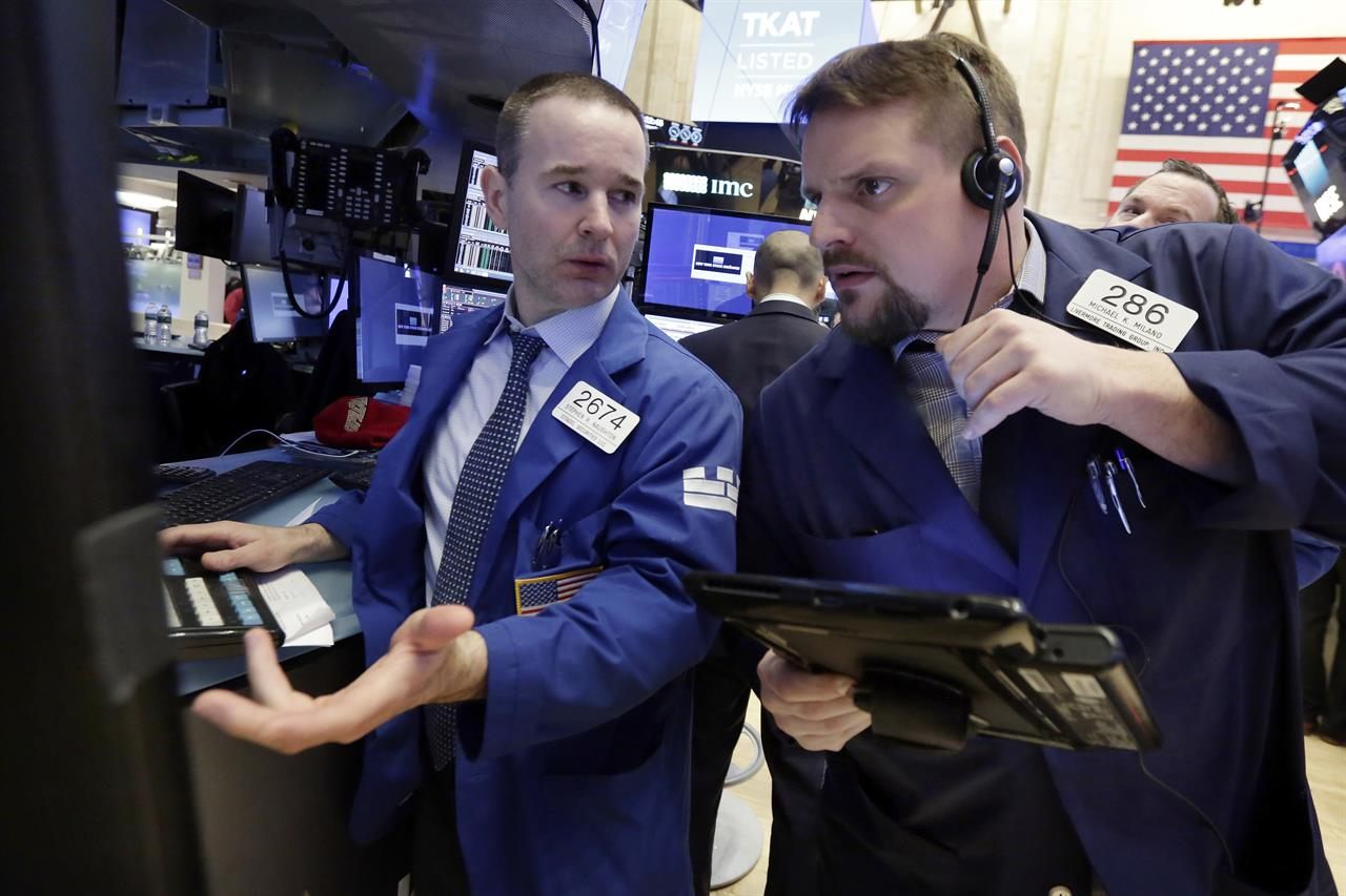 Indexes inch back upward as tech stocks rise; Nike plunges