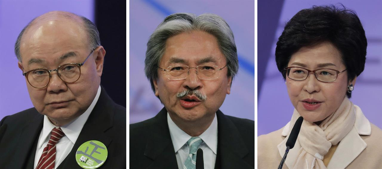 This combination of three file photos taken March 14, 2017 shows Hong Kong chief executive candidates, from left, former judge Woo Kwok-hing, former Financial Secretary John Tsang and former Chief Secretary Carrie Lam, speaking during a chief executive election debate in Hong Kong. Hong Kong's next leader will be chosen Sunday, March 26, 2017 by an election committee stacked with pro-Beijing elites who heed the wishes of China's communist leaders rather than the semiautonomous region's voters. A closer look at each potential replacement to unpopular incumbent Leung Chun-ying, whose term ends in June.