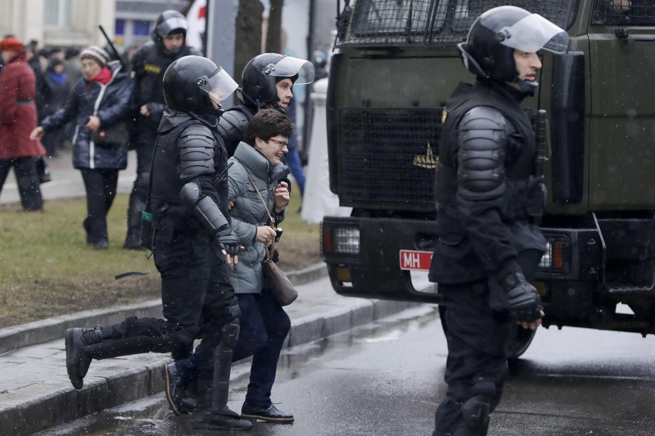 Belarus police detain a woman during an opposition rally in Minsk, Belarus, Saturday, March 25, 2017. A cordon of club-wielding police blocked the demonstrators' movement along Minsk's main avenue near the Academy of Science. Hulking police detention trucks were deployed in the city center.