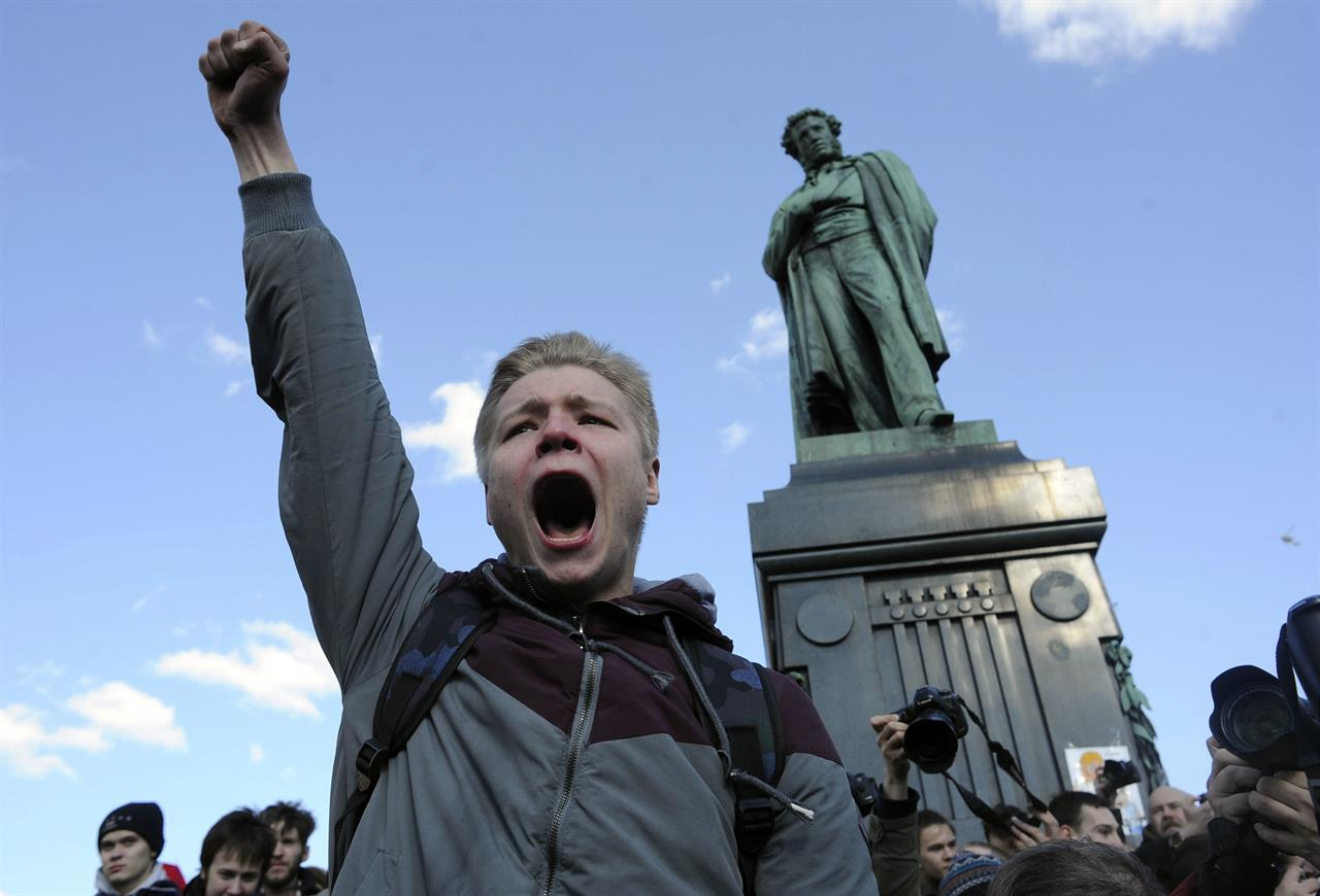 A man shouts anti-government slogans in downtown Moscow, Russia on Sunday, March 26, 2017. Thousands of people crowded into Moscow's Pushkin Square on Sunday for an unsanctioned protest against the Russian government, the biggest gathering in a wave of nationwide protests that were the most extensive show of defiance in years.
