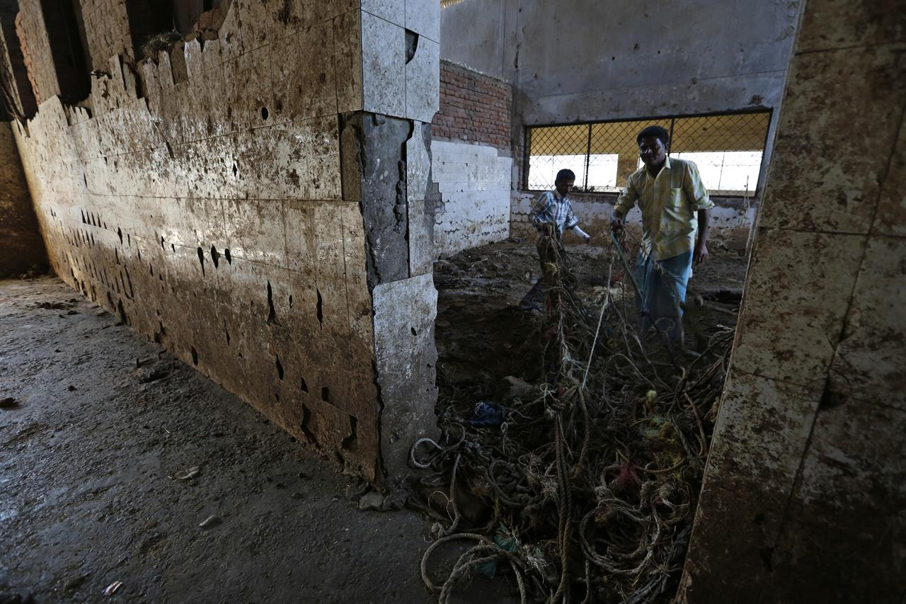 In this Sunday, March 26, 2017 photo, workers remove ropes of slaughtered animals at a slaughter house that was shutdown by authorities in Allahabad, India. India's most populous state is running out of meat. After the Hindu right-wing Bharatiya Janata Party came to power in Uttar Pradesh this month on the back of a resounding electoral victory and named a Hindu priest-cum-politician as the state's chief minister, the government began cracking down on illegal slaughterhouses and meat shops.