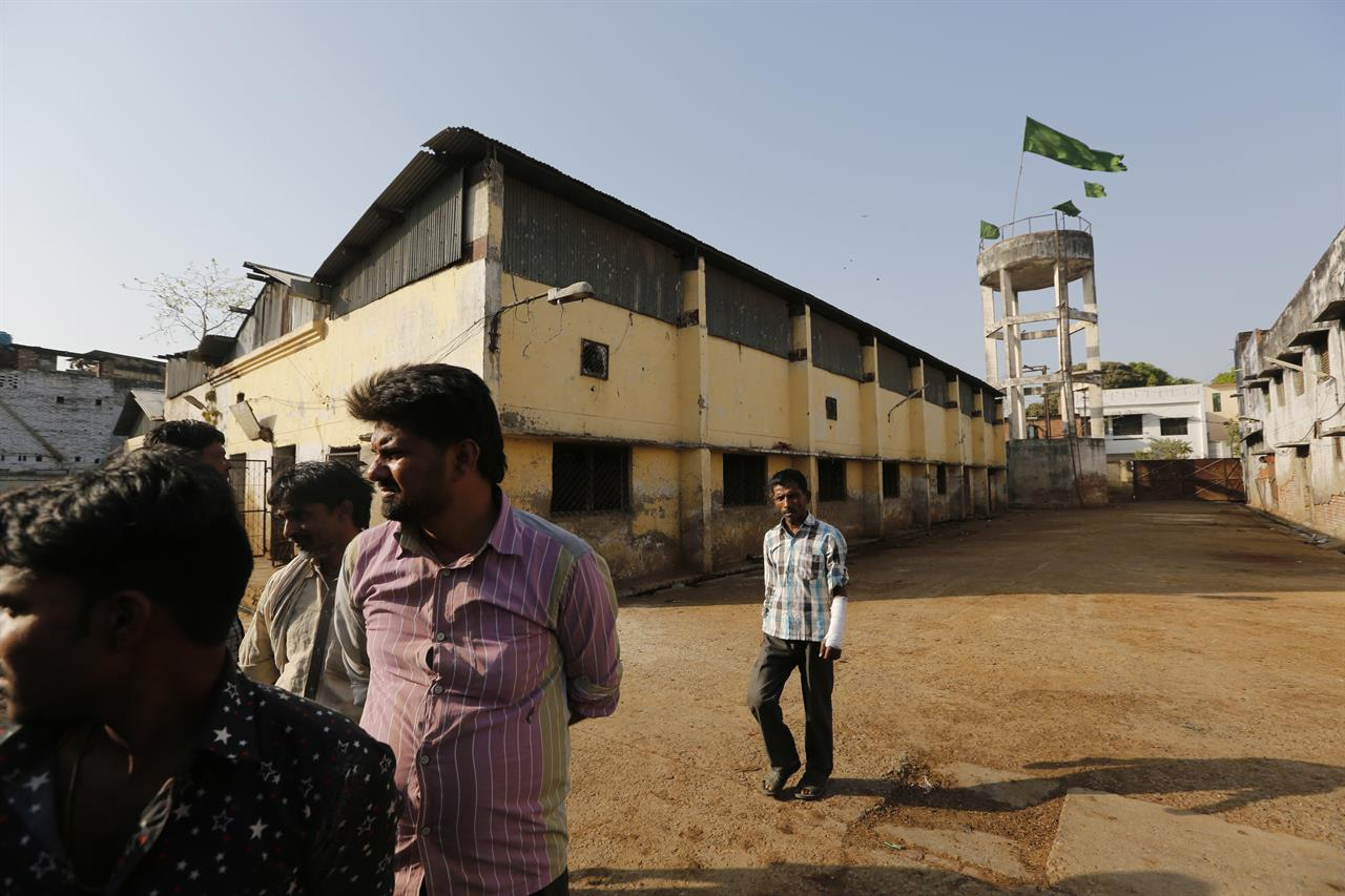 In this Sunday, March 26, 2017 photo, workers stand outside a slaughter house where they used to work after the same was shutdown by authorities in Allahabad, India. India's most populous state is running out of meat. After the Hindu right-wing Bharatiya Janata Party came to power in Uttar Pradesh this month on the back of a resounding electoral victory and named a Hindu priest-cum-politician as the state's chief minister, the government began cracking down on illegal slaughterhouses and meat shops.