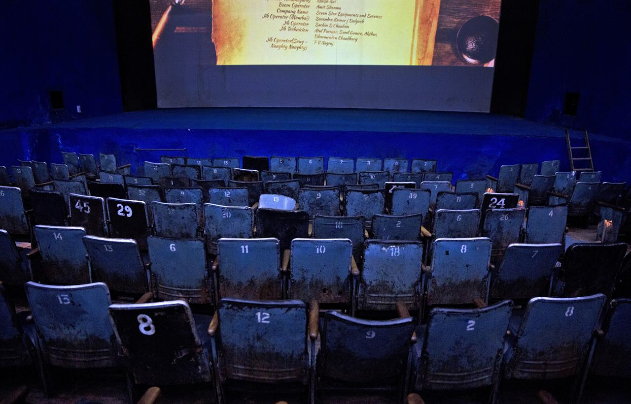 In this Tuesday, March 28, 2017 photo, seats are seen empty before the final movie screening at Regal Theater in New Delhi, India. From Bollywood superstars to political heavyweights, the Regal theater had hosted some of India's biggest names over more than eight decades. But with nostalgic theater-goers singing their way to the exits after a final showing of a Bollywood classic, the iconic New Delhi theater has closed its doors to make way for a multiplex.