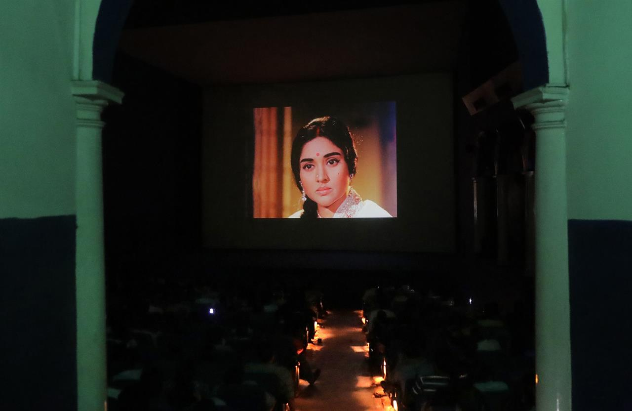"In this Friday, March 31, 2017 photo, Indians watch the Bollywood classic Sangam at Regal Theater in New Delhi, India. The Indian capital's iconic Regal Theatre signed off on Thursday night after more than eight decades with nearly 600 movie buffs cheering a 1964 Bollywood classic at a final screening. For its final screening, the theater showed ""Sangam,"" or Union of Two Hearts, on Thursday night in a tribute to producer-director Raj Kapoor, Bollywood's biggest showman, who patronized the Regal and premiered his movies there in the 1950s, '60s and '70s."
