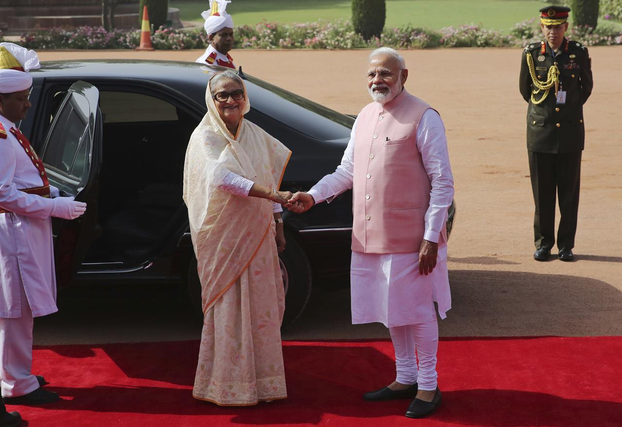 Indian Prime Minister Narendra Modi shakes hand with his Bangladeshi counterpart Sheikh Hasina at the Presidential Palace in New Delhi, India, Saturday, April 8, 2017. India and Bangladesh have signed a slew of agreements, including a $4.5 billion concessionary line of credit from India for development projects in Bangladesh, as the South Asian neighbors try to deepen their ties.