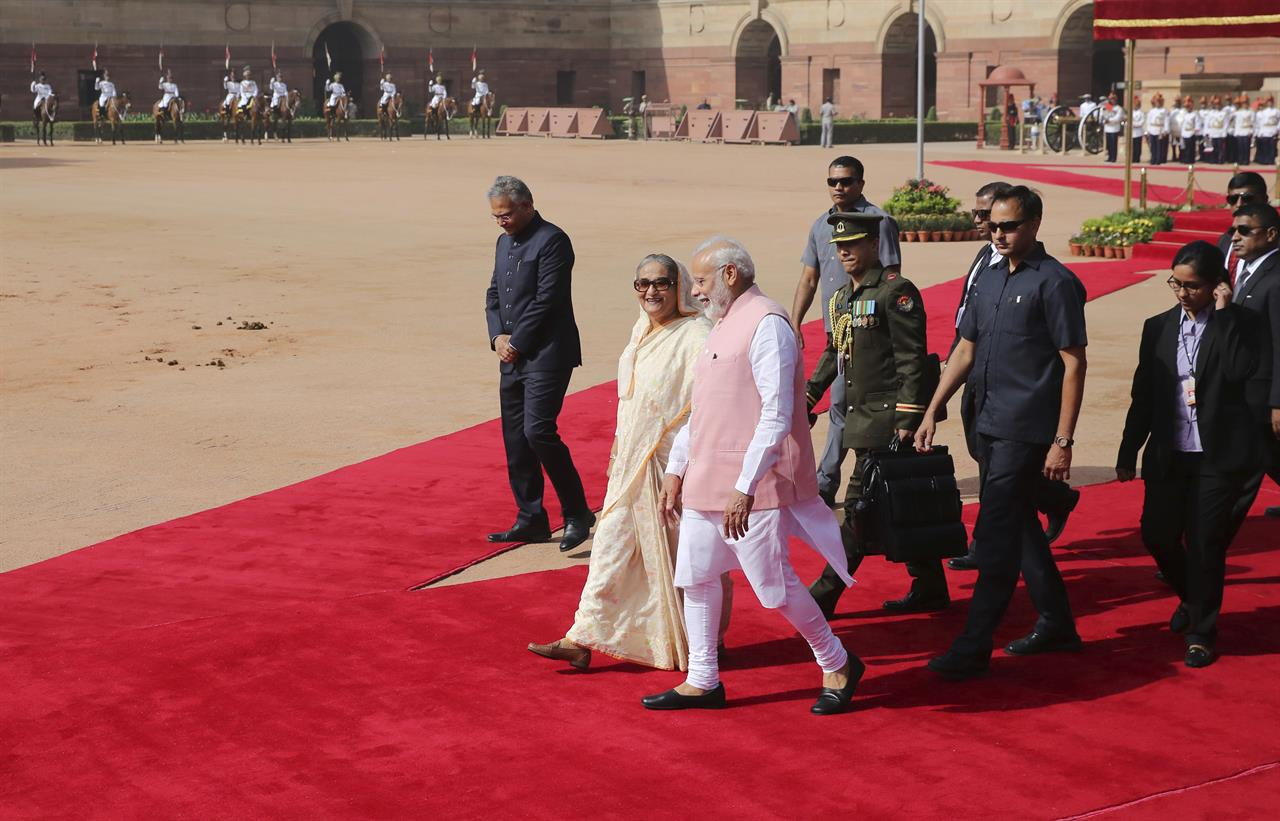Indian Prime Minister Narendra Modi walks with his Bangladeshi counterpart Sheikh Hasina at the Presidential Palace in New Delhi, India, Saturday, April 8, 2017. India and Bangladesh have signed a slew of agreements, including a $4.5 billion concessionary line of credit from India for development projects in Bangladesh, as the South Asian neighbors try to deepen their ties.