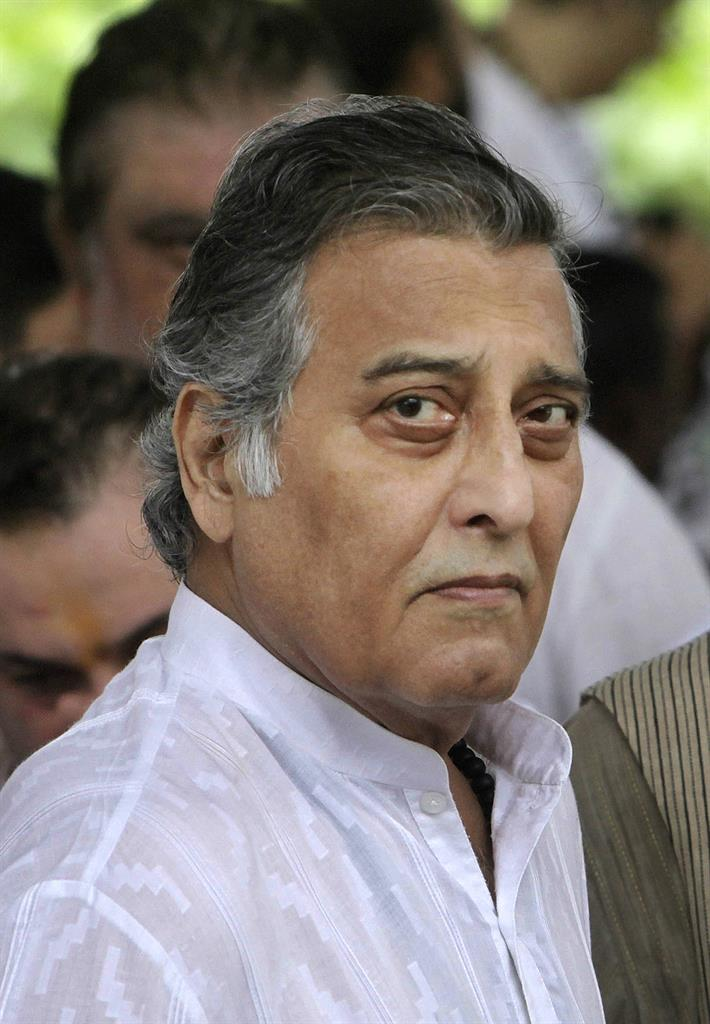 In this Aug. 15, 2011, file photo, Bollywood actor Vinod Khanna attends the funeral of versatile Indian actor Shammi Kapoor in Mumbai. A hospital official says Vinod Khanna, a dashing Bollywood actor turned politician, has died of cancer in Mumbai. He was 70.