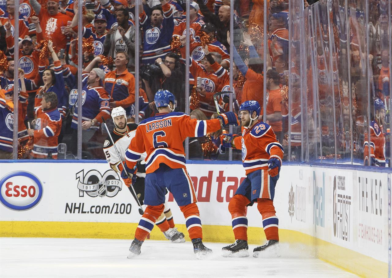 383a8afd99d Anaheim Ducks' Ryan Getzlaf (15) skates by as Edmonton Oilers' Adam Larsson  (6) and Leon Draisaitl (29) celebrate a goal during the first period in  Game 6 ...