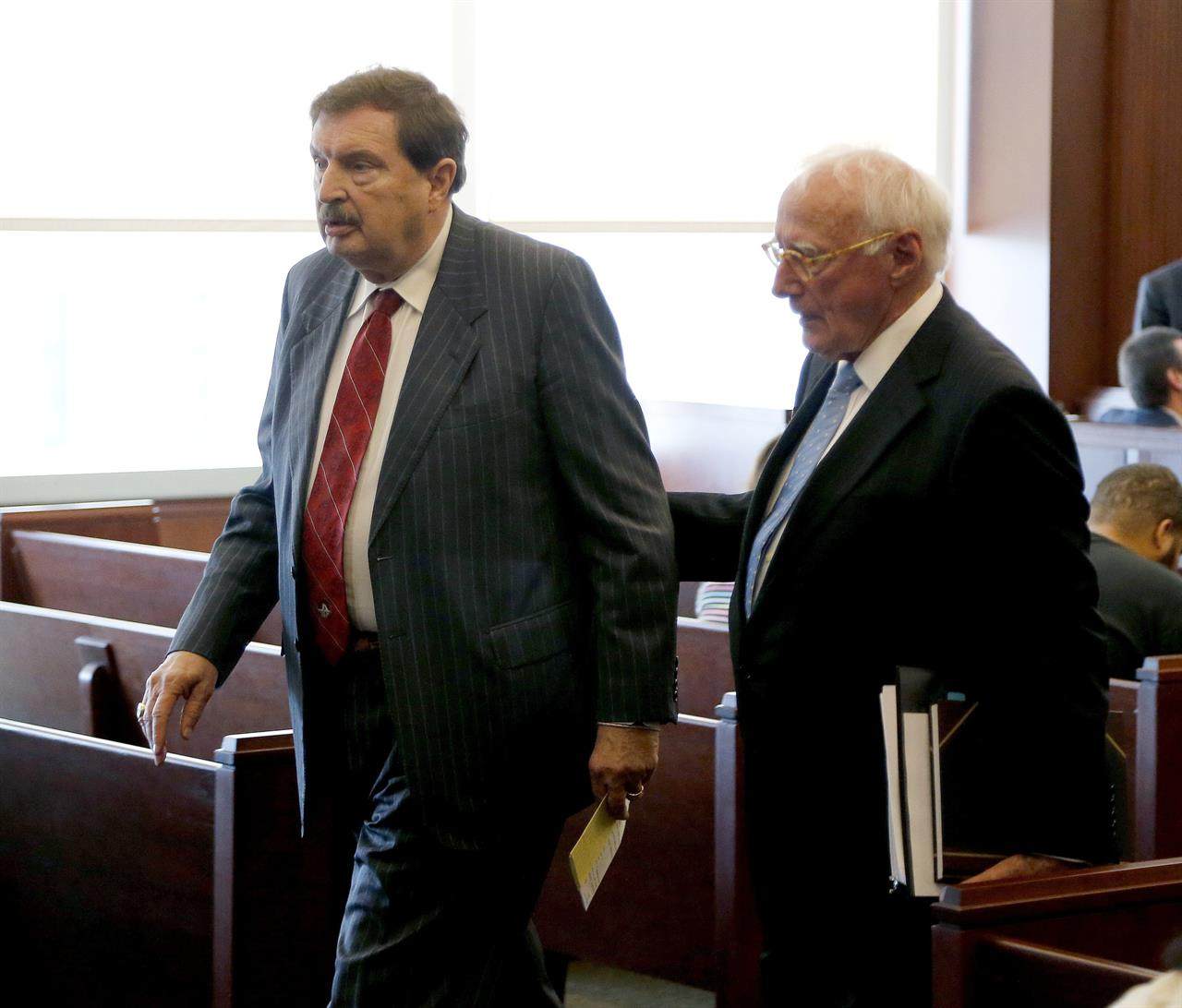 Heading to prison, Hartsell gets probation after state plea