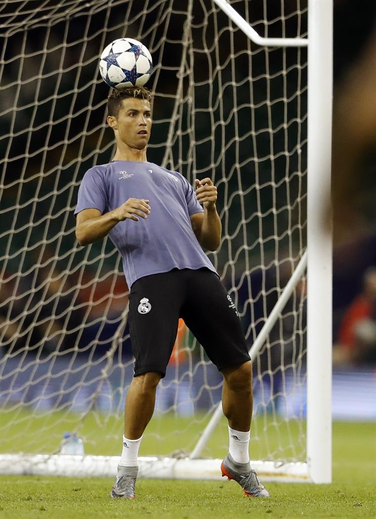 d6c9d694430 Real Madrid s Cristiano Ronaldo controls a ball during a training session  at the Millennium Stadium in Cardiff