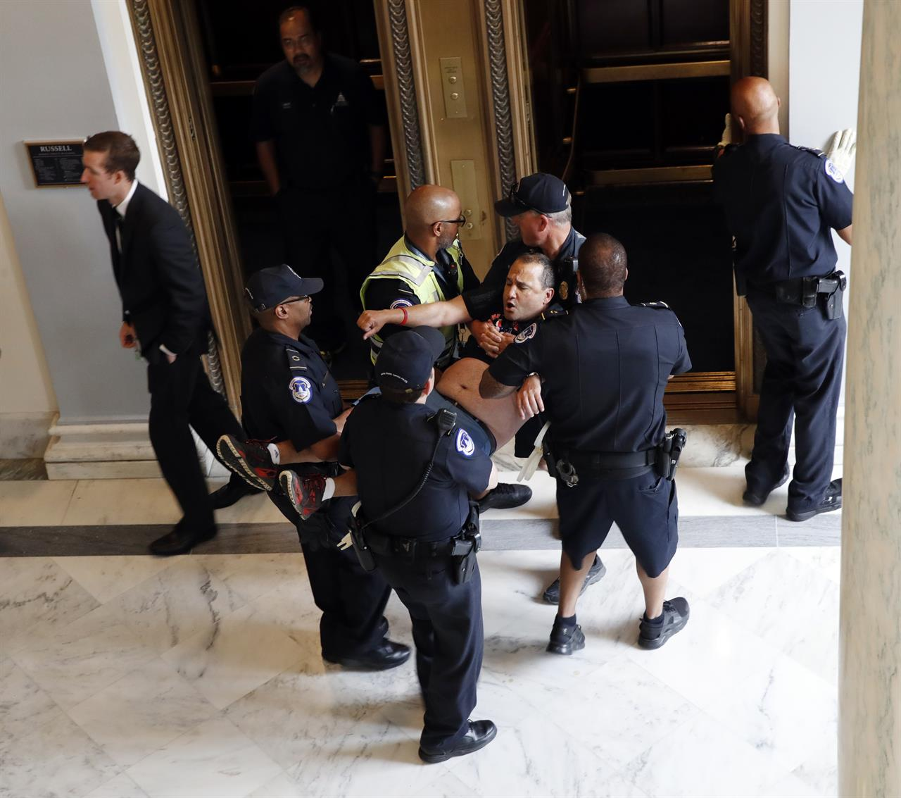 Colorado Shooting Radio Traffic: Capitol Police Arrest Protesters Outside McConnell's