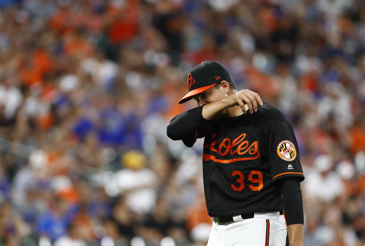 Russell's 9th-inning homer lifts Cubs past Orioles 9-8 ...
