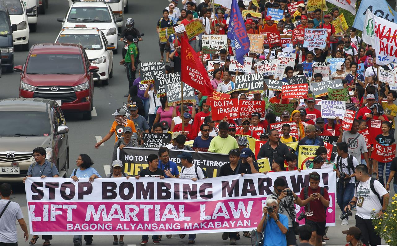 philippine martial law Martial law in the philippines: the methods of regime survival david wurfel the philippines was the latest of the colonially inspired experi- ments in constitutional democracy within southeast asia to suc- cumb to a palace coup because the filipino citizenry had a longer experience in the uses of competitive elections,.