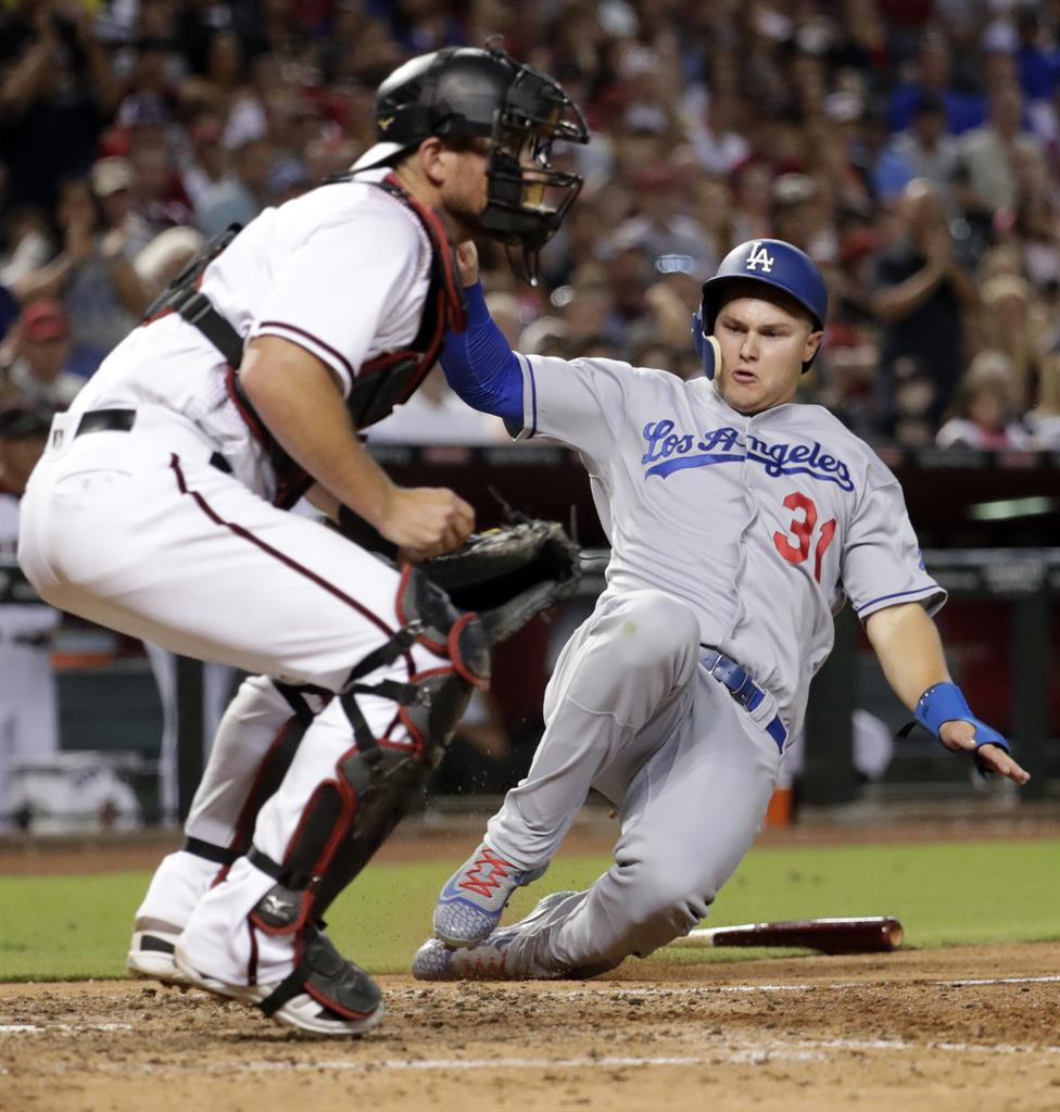 Dodgers win 80th game of season, rallying over
