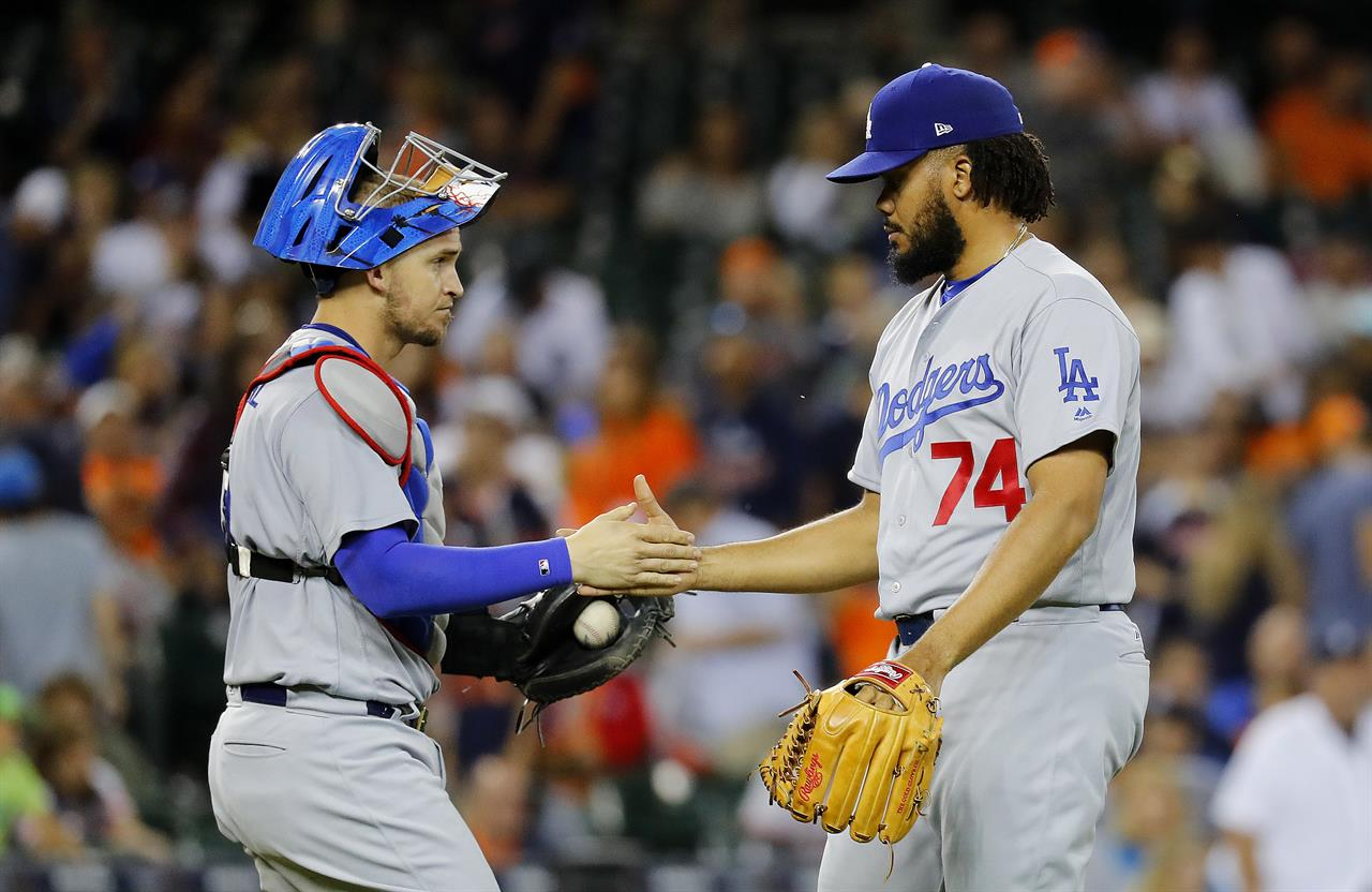52f65c9d0 Los Angeles Dodgers relief pitcher Kenley Jansen (74) and catcher Yasmani  Grandal celebrate after the final out against the Detroit Tigers in the  ninth ...