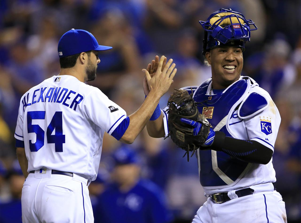 c7615f1d5 Kansas City Royals relief pitcher Scott Alexander (54) and catcher Salvador  Perez (13) celebrate following a baseball game against the Colorado Rockies  at ...