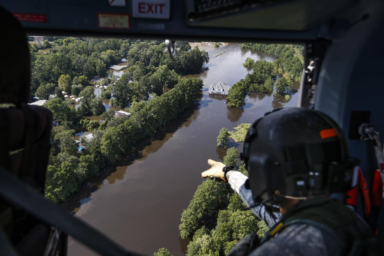 1 2017 File Photo Sgt Destry Riggs Scans Flooded Areas During A Search And Rescue Operation Run By The 36th Combat Aviation Brigade Of Texas