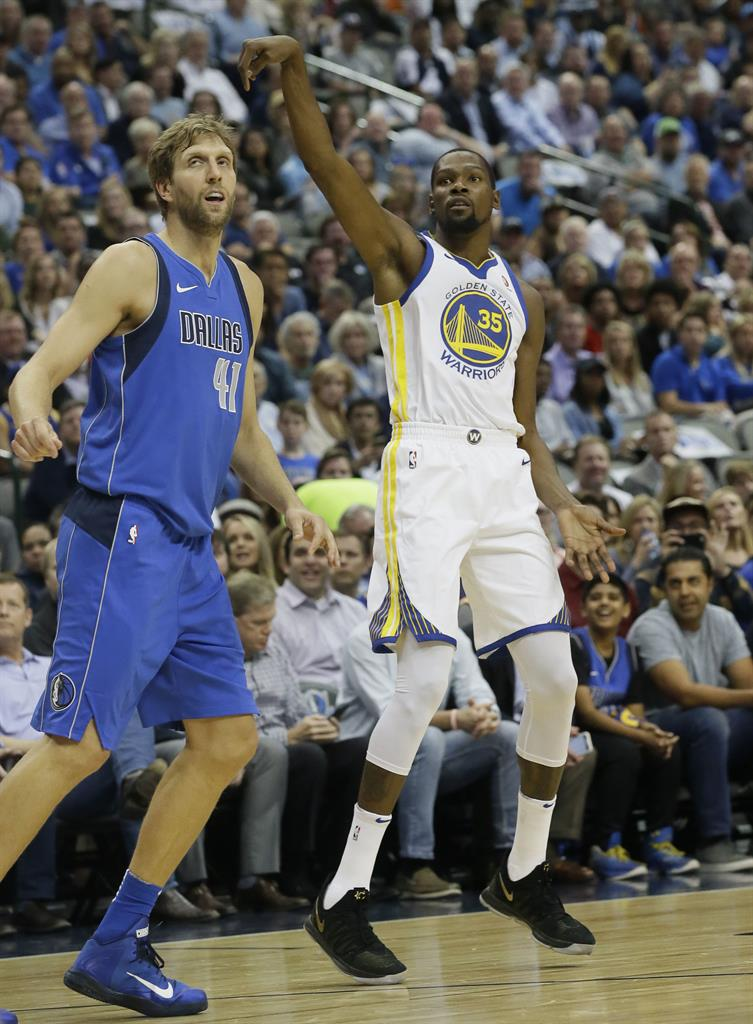 c5c33622f201 Golden State Warriors forward Kevin Durant (35) watches his shot fall good against  Dallas Mavericks forward Dirk Nowitzki (41) of Germany during the first ...