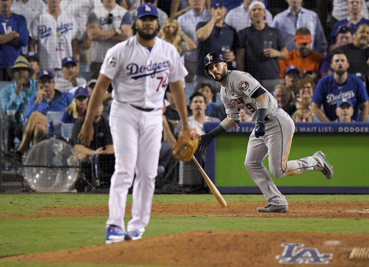 c6bdc3c9a Houston Astros  Marwin Gonzalez watches his home run off Los Angeles  Dodgers relief pitcher Kenley Jansen during the ninth inning of Game 2 of  baseball s ...