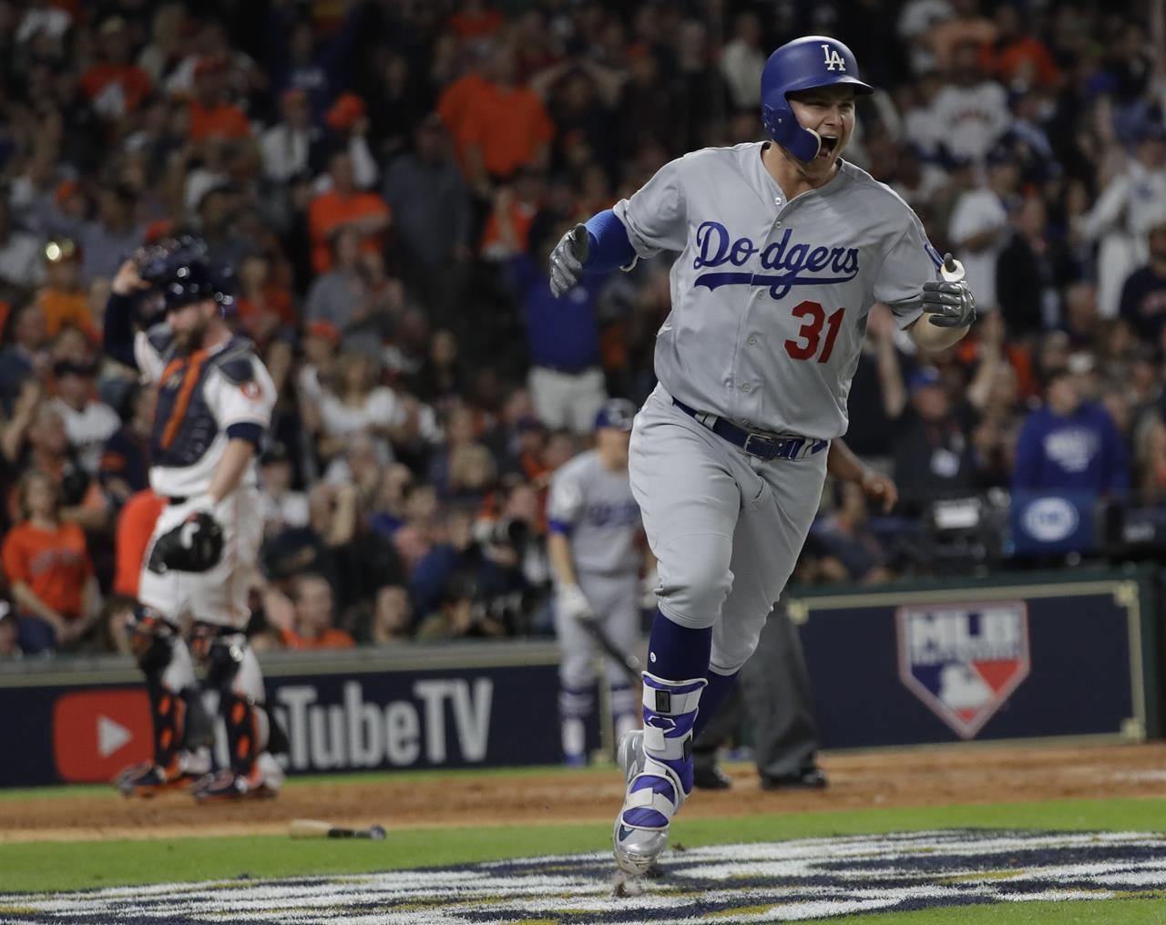 dca2e03ac Los Angeles Dodgers  Joc Pederson reacts after hitting a three-run home run  during the ninth inning of Game 4 of baseball s World Series against the  Houston ...