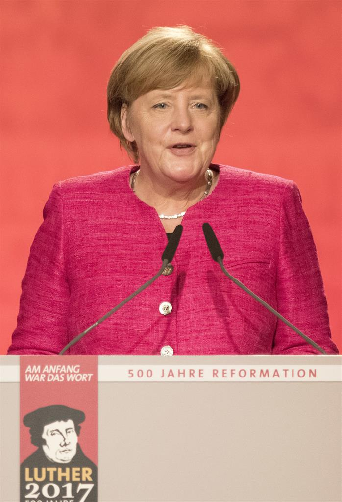 merkel catholic girl personals Dating across the catholic/protestant divide  august 9, 2011   chris castaldo   the man whom ann was dating didn't understand why their relationship was terminal.