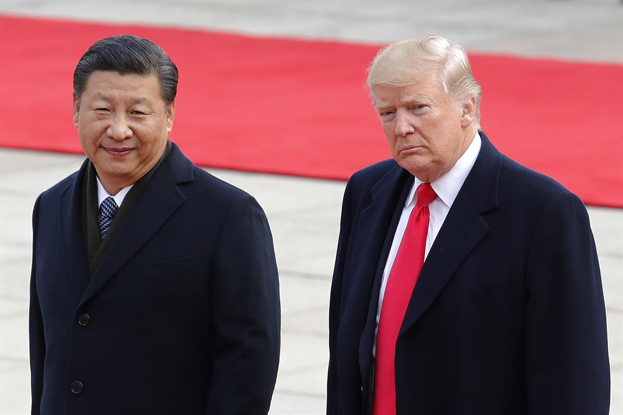 U s president donald trump right walks with chinese president xi jinping during a welcome ceremony at the great hall of the people in beijing thursday