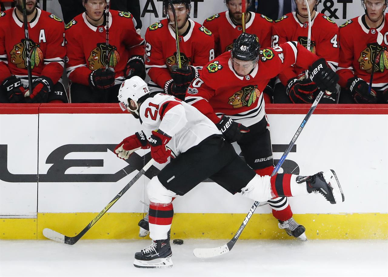 ... Wood s hat trick helps Devils  rally to beat Blackhawks d80117830