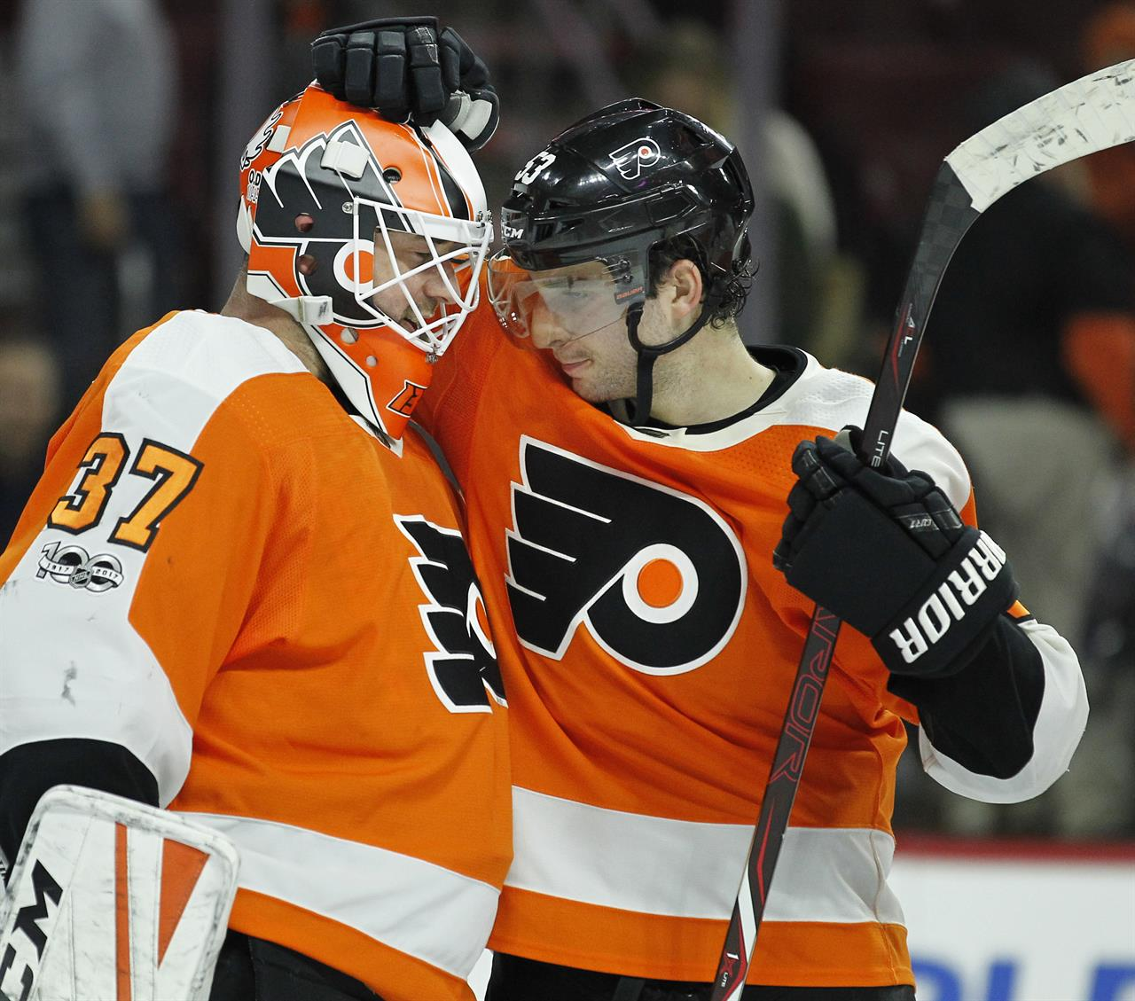 beef54e608a Philadelphia Flyers' Brian Elliott, left and Shayne Gostisbehere celebrate  at the end of the third period of an NHL hockey game against the Toronto  Maple ...