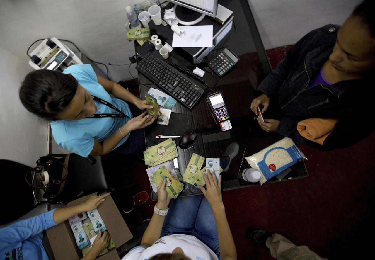 Poor Venezuelans launch local currency amid cash crunch ...