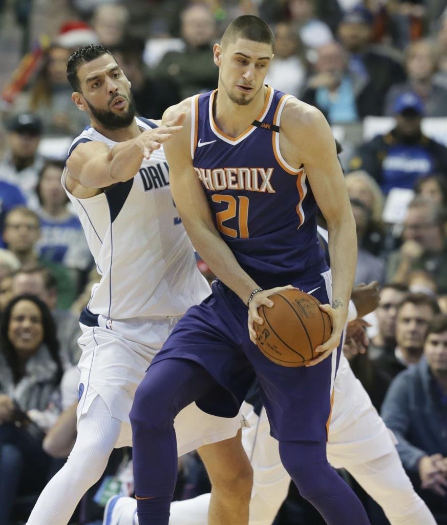 87949a91c5c9 Phoenix Suns center Alex Len (21) is defended by Dallas Mavericks center  Salah Mejri (50) during the first half of an NBA basketball game in Dallas