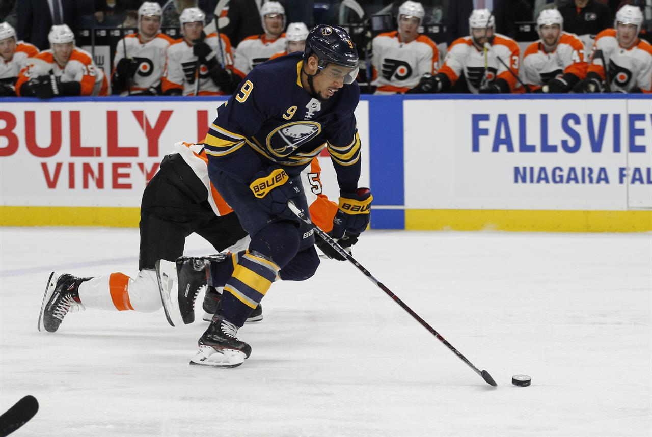 7abdc2f6873 Buffalo Sabres forward Evander Kane (9) skates the puck into the zone  during the first period of an NHL hockey game against the Philadelphia  Flyers