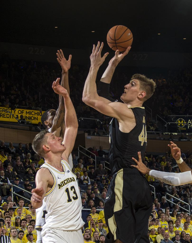 4f0c57cd02c Purdue center Isaac Haas shoots over Michigan forward Moritz Wagner (13)  during the first half of an NCAA college basketball game at Crisler Center  in Ann ...