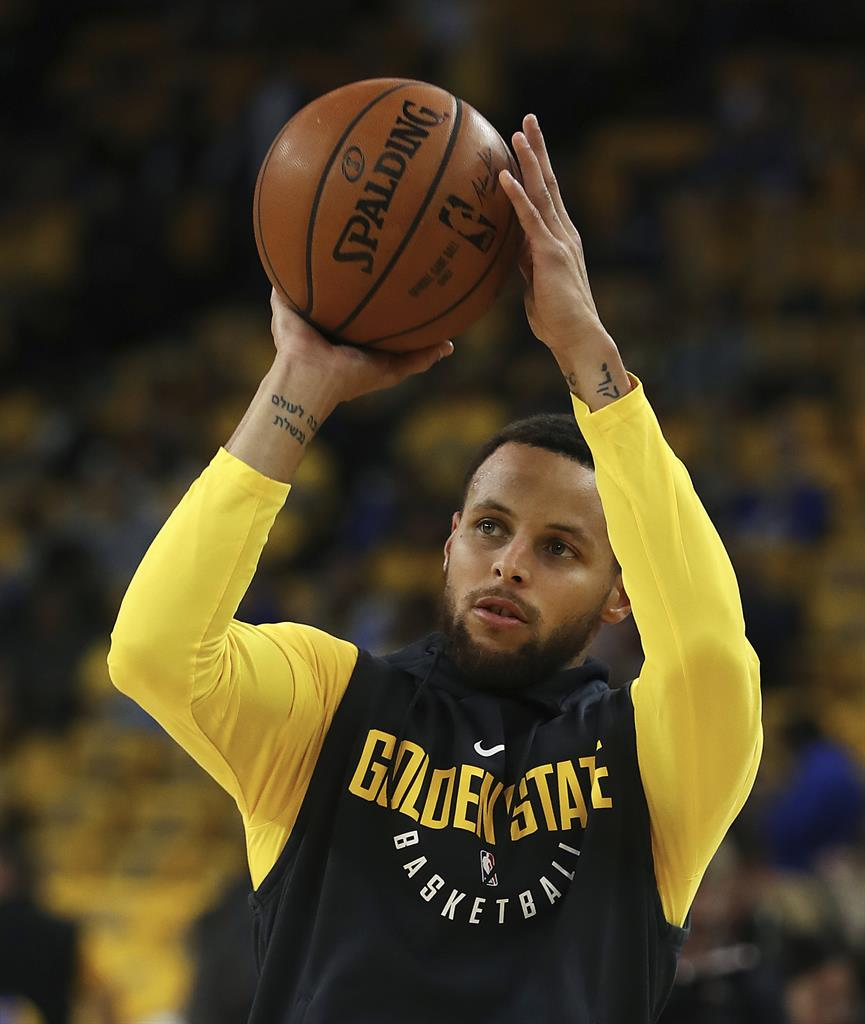a75b2c5b5548 Golden State Warriors  Stephen Curry warms up prior to Game 2 of a first-round  NBA basketball playoff series against the the San Antonio Spurs