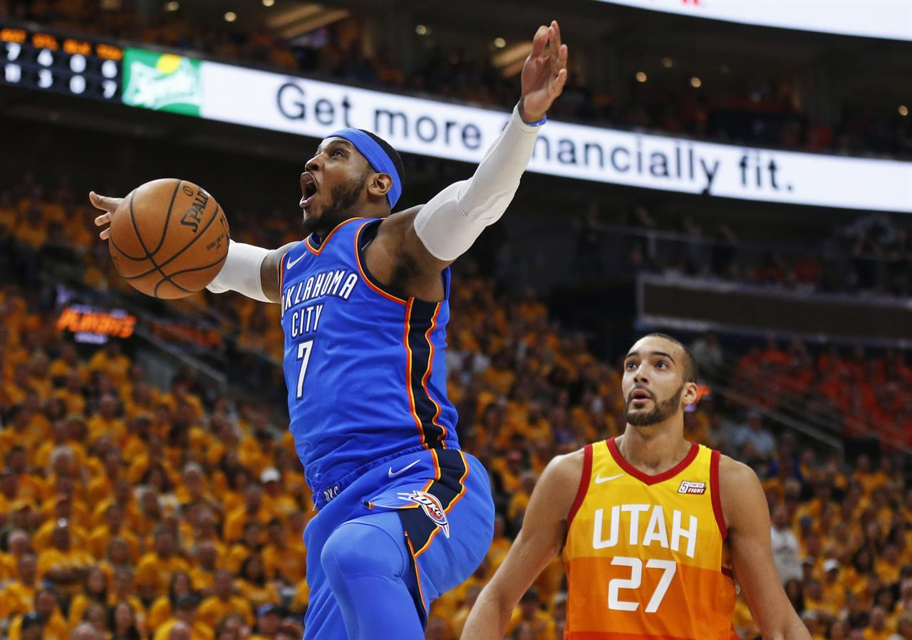 premium selection bcd1e af02f Oklahoma City Thunder forward Carmelo Anthony (7) reacts after dunking the  ball in front ofUtah Jazz center Rudy Gobert (27) during the first half  during ...