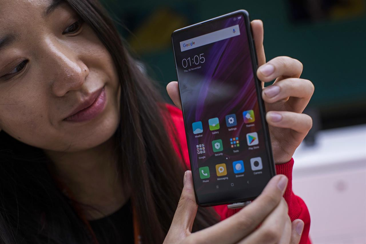 Chinese smartphone maker xiaomi files for hong kong ipo for Documents xiaomi