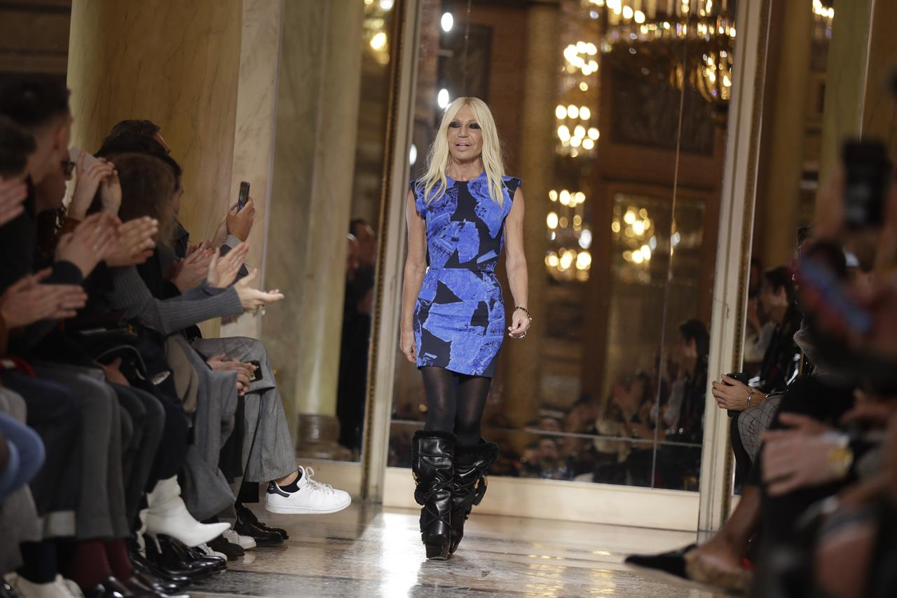 ecaeb854187 Donatella Versace acknowledges the applause after presenting her men s Fall- Winter 2018-19 collection, that was presented in Milan, Italy, Saturday, Jan .13, ...