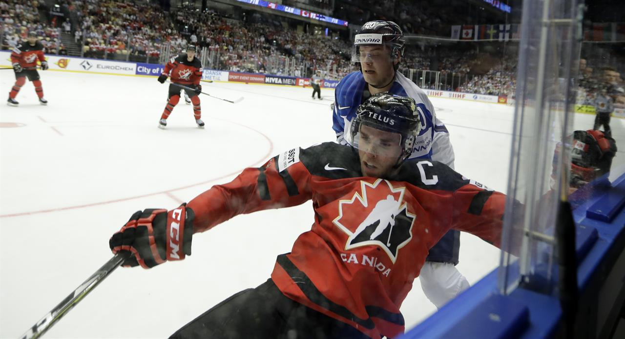 Finland upsets Canada, Russia edges Swiss in ice hockey