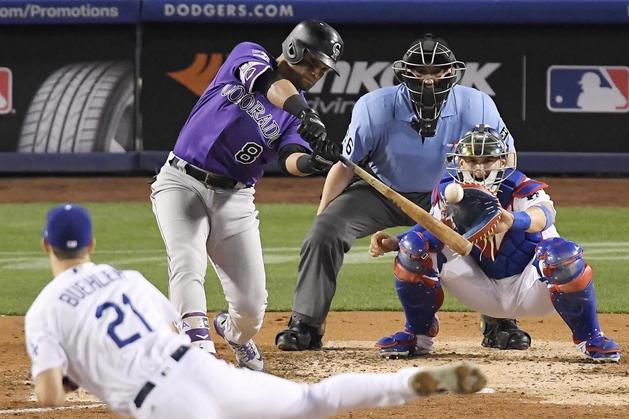 594250fa3 Colorado Rockies' Gerardo Parra, second from left, hits a solo home run off  Los Angeles Dodgers starting pitcher Walker Buehler during the fifth inning  of a ...