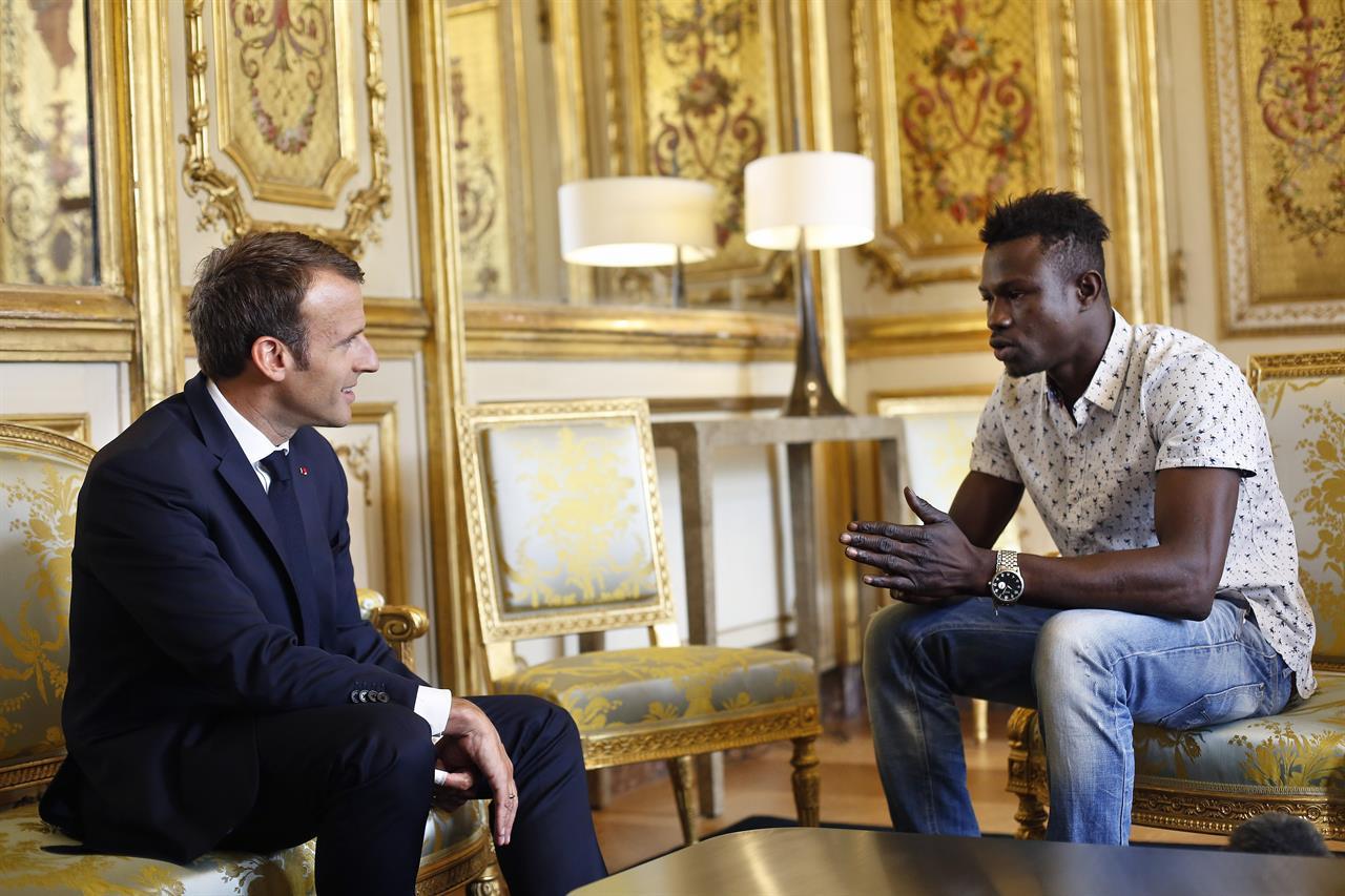 France: Macron rewards migrant hero who saved dangling child