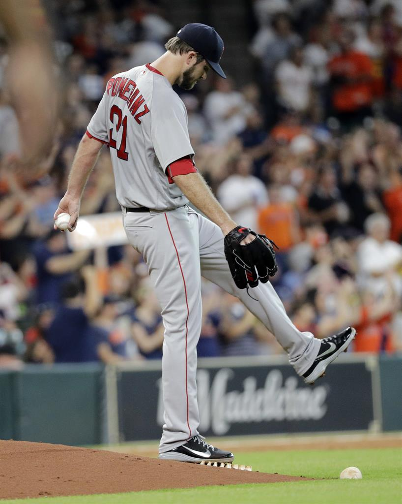6dbe6f7f052 Boston Red Sox starting pitcher Drew Pomeranz cleans his cleats after  giving up a two-run home run to Houston Astros  Carlos Correa during the  first inning ...
