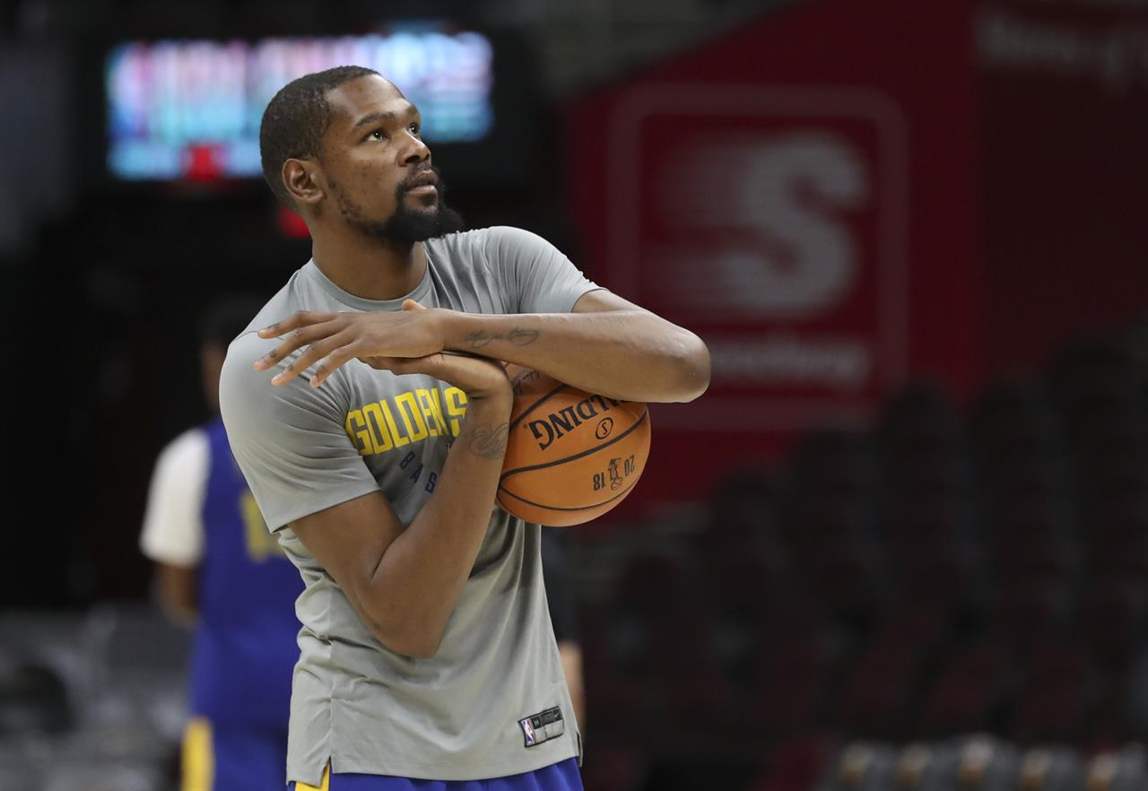83d7a2082aff Golden State Warriors forward Kevin Durant (35) warms up as the basketball  team's practiced during the NBA Finals, Wednesday, June 7, 2018, in  Cleveland.