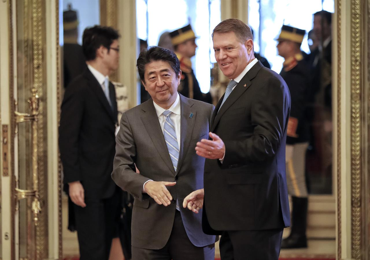 Japanese pm lands in romania as leader he is to meet resigns am 1190 wafs atlanta ga - Houses romanias political leaders ...